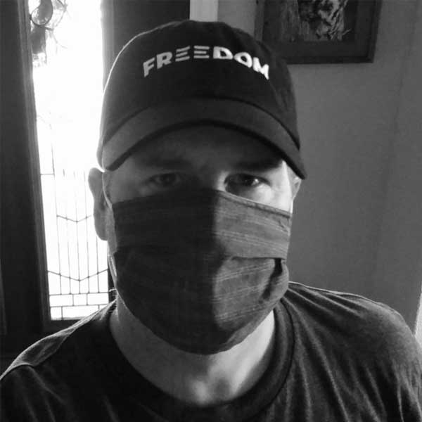 Picture of the author wearing a Freedom baseball cap supporting Black Lives Matter and a cloth face mask used as protection from covid-19.